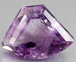 amethyst with a fancy cut and color bands